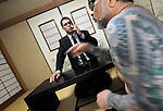 "JJake Adelstein, a former reporter at Japan's largest daily newspaper, Yomiuri Shimbun, and author of ""Tokyo Vice"", speaks with his bodyguard, a former yakuza mobster who goes by the name ""Mochizuki,"" at an undisclosed location in Japan on Aug. 29, 2008. In 2005 American Adelstein uncovered a scandal involving senior members of Japan's mafia, the yakuza, visiting a medical center in Los Angeles to undergo liver transplants, despite being bared from entry due to having criminal records or suspected affiliation with Japanese organized crime groups. Within days, however, Adelstein was visited by mob members and told to either ""erase the story or be erased."" He took the former option and resigned from the Yomiuri, though a leak of his story at the time of this interview pushed Adelstein and his family into hiding..Photographer: Robert Gilhooly"