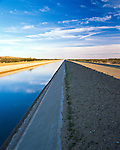 "All-American Canal, an 80 mi (129 km) long aqueduct located in southeastern California. It conveys water from the Colorado River to the Imperial Valley and to nine cities. Canal systems irrigates up to 630,000 acres (250,000 ha) of good crop land and has made possible a greatly increased crop yield in this semi-desert area. Largest irrigation canal in the world, carrying a maximum of 26,155 cubic feet per second (740.6 m3/s). Runs parallel to the Mexico California border for several miles and with over 500 people having drowned in the canal since 1997, it has been called ""the Most Dangerous Body of Water in the U.S."""