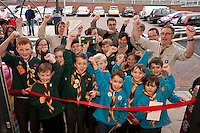 Scouts and Beavers from 1st Hasland Scouts cut the ribbon to open the store