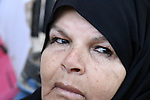 "A Palestinian Hadia Qudaih 70, puts a traditional eye cosmetic ""Arab kohl or Black eyeliner"" in the eye of a woman at her home in Khan Younis in the southern of Gaza strip, on February 17, 2020. Eye liner or eyeliner is a cosmetic used to define the eyes. It is applied around the contours of the eye(s) to create a variety of aesthetic effects. The history of cosmetics traverse from at least 7,000 years and is common in mostly every society. Photo by Mariam Dagga"