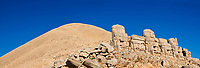 Headless seated statues in front of the stone pyramid 62 BC Royal Tomb of King Antiochus I Theos of Commagene, east Terrace, Mount Nemrut or Nemrud Dagi summit, near Adıyaman, Turkey