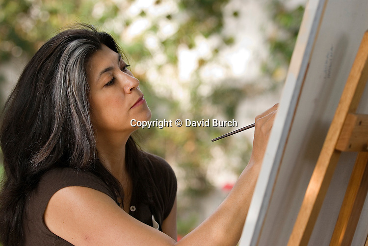 Hispanic woman painting