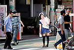 """August 30, 2011 - Tokyo, Japan - A maid cos-player hands out leaflets on the street in Akihabara. Akihabara is a well-known district in Tokyo for people who have obsessive interests particularly in manga, anime or video games. The Japanese term used for these types of people is called """"otaku."""" (Photo by Yumeto Yamazaki/AFLO)"""
