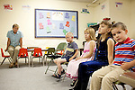 Children, from left to right, Will Ward, Moriah Harimon, Autumn Brawley and Ayden Brawley listen to Ray Shaffer as he leads them in song in Sunday School and Cindy Denton (left) looks on at First Baptist Church in Thermopolis, Wyoming August 21, 2011.