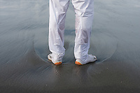 A festival supporter's feet leave marks in the sand as he stands on the surf line during the Hamaorisai Matsuri that takes place on Southern Beach in Chigasaki, near Tokyo, Kanagawa, Japan Monday July 18th 2011. The festivals marks the celebration of Marine Day and the rescuing of a divine image that was washed ashore in the area. Over thirty Mikoshi or portable shrines are carried through the night from surrounding shrines to arrive on the beach for sunrise. There they are blessed and then carried into the surf to purify them.