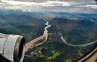 Laos. Flying over the Mekong and nam Ou (r.) rivers at Pak Ou.
