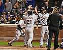 (L-R) Conor Gillaspie, Joe Panik, Brandon Crawford (Giants),<br /> OCTOBER 5, 2016 - MLB :<br /> Conor Gillaspie of the San Francisco Giants celebrates with his teammates Joe Panik and Brandon Crawford at home plate after hitting a three-run home run in the ninth inning during the National League Wild Card Game against the New York Mets at Citi Field in Flushing, New York, United States. (Photo by Hiroaki Yamaguchi/AFLO)
