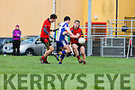 Jack Brosnan and Stephen O'Sullivan Glenbeigh/Glencar and Colm O'Neill Keel challenge for the loose ball during the Mid Kerry semi final in Glenbeigh on Sunday