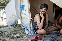 Pictured: A young man smokes in his tent.<br /> Re: Everyday life at the Moria refugee camp on the island of Lesbos, Greece.