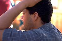 Man age 25 gazing with hand on head.  St Paul  Minnesota USA