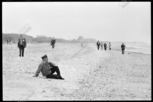 At Utah Beach, a veteran sits on the beach, Normandy, France, June 6, 1979.