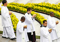 Priests carry hosts for the Communion during the Easter mass celebrated by Pope Francis in St. Peter's Square at the Vatican, April 21, 2019.<br /> UPDATE IMAGES PRESS/Riccardo De Luca<br /> <br /> STRICTLY ONLY FOR EDITORIAL USE
