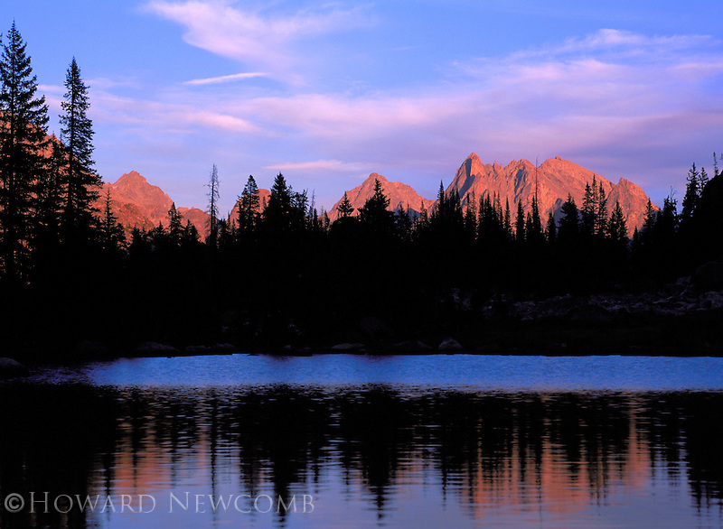 Last light strikes the rugged peaks of the Wind River Range at Clarks Lake, Wyoming.