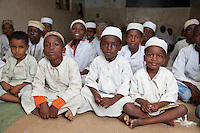 Zanzibar, Tanzania.  Young Boys in Madrassa (Koranic School).