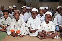Zanzibar, Tanzania.  Young Boys in Madrassa (Koranic School).