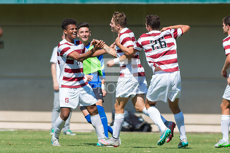 Stanford, CA - September 20, 2015: Jordan Morris celebrates his game winning goal with Brian Nana-Sinkam and other teammates during the Stanford vs Davidson men's soccer match in Stanford, California.  The Cardinal defeated the Wildcats 1-0 in overtime.
