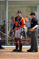 Baltimore Orioles catcher Austin Wynns (45) and umpire Junior Valentine during a minor league Spring Training game against the Minnesota Twins on March 16, 2016 at CenturyLink Sports Complex in Fort Myers, Florida.  (Mike Janes/Four Seam Images)