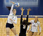 SIOUX FALLS, SD - DECEMBER 8:  Emma Lange #7 from Concordia St. Paul hammers the ball past Jana Potic #9 from American International during their quarterfinal match at the Women's DII Volleyball Championships at the Sanford Pentagon in Sioux Falls, SD. (Photo by Dave Eggen/Inertia)