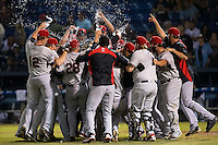 The Hickory Crawdads celebrate after defeating the Asheville Tourists 5-1 to sweep the South Atlantic League Championship at McCormick Field on September 17, 2015 in Asheville, North Carolina. (Brian Westerholt/Four Seam Images)