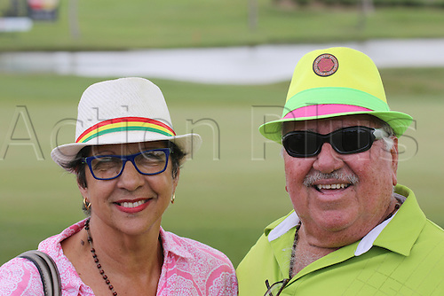 26.03.2016. Rio Grande, Puerto Rico.  A couple of fans in colorful hats in the third  round of the Puerto Rico Open, in Rio Grande, PR