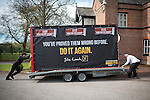 © Joel Goodman - 07973 332324 . 01/05/2015 . Manchester , UK . Activists wheel a party advertising trailer in to place for a Liberal Democrat party rally at Chorlton-cum-Hardy Golf Club . Liberal Democrat party leader Nick Clegg visits the constituency of Manchester Withington to deliver a speech on the NHS and campaign with local candidate John Leech . Photo credit : Joel Goodman