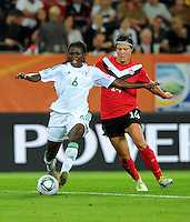 Melissa Tancredi (r) of team Canada and Helen Ukaonu of team Nigeria during the FIFA Women's World Cup at the FIFA Stadium in Dresden, Germany on July 5th, 2011.