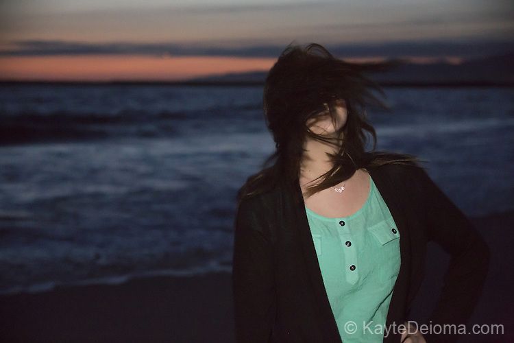 Portrait of a teenage girl at the beach at sunset
