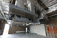 A view of the new vents and in the catering and education kitchen Thursday, July 30, 2020, of the the new expansion in the Fayetteville Public Library still under construction. The new addition of 82,500-square-feet will nearly double the size of the 88,000-square-foot main library. Check out nwaonline.com/200802Daily/ and nwadg.com/photos for a photo gallery.<br /> (NWA Democrat-Gazette/David Gottschalk)
