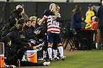09 February 2012: Julie Johnston (USA) (26) is hugged by Heather O'Reilly (USA) before entering her first game as a senior international player. The United States Women's National Team played the Scotland Women's National Team at EverBank Field in Jacksonville, Florida in a women's international friendly soccer match. The U.S. won the game 4-1.