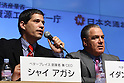 Apr. 26 - Tokyo, Japan - Shai Agassi (L), founder and chief executive officer of Better Place delivers a speech during a press conference to announce the world's first switchable-battery electric taxi in Tokyo on April 26, 2010. Global electric vehicle service provider Better Place demonstrated the taxi with the Japanese Ministry of Economy, Trade, and Industry, and Tokyo's largest taxi operator Nihon Kotsu.