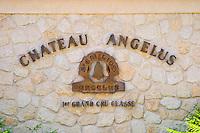 Sign on stone wall saying Chateau Angelus 1er premier first cru classe Saint Emilion Bordeaux Gironde Aquitaine France