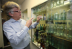 Author Fred Holabird talks about his extensive collection of antique drug store bottles that he's found around the state. Holabird, who just released his second volume of his The Nevada Bottle Book series, talks in his office in Reno, Nev. on Tuesday, Feb. 14, 2017. (Cathleen Allison/Las Vegas Review-Journal)