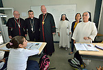 Cardinal Timothy Dolan (center), the archbishop of New York, visits with students displaced by war at the Al Bishara School run by the Dominican Sisters of St. Catherine of Siena in Ankawa, near Erbil, Iraq, on April 9, 2016. On Dolan's right is Bashar Matti Warda, the Chaldean Catholic archbishop of Erbil. On the far left is Bishop William Murphy of Rockville Centre, New York. On the far right is Sister Huda Sheeto, the school's principal.<br /> <br /> Dolan, chair of the Catholic Near East Welfare Association, was in Iraqi Kurdistan with other church leaders to visit with Christians and others displaced by ISIS. The Dominican Sisters were themselves displaced by ISIS, and have established schools and other ministries among the displaced.