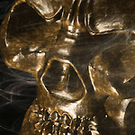A conceptual image of a golden skull face