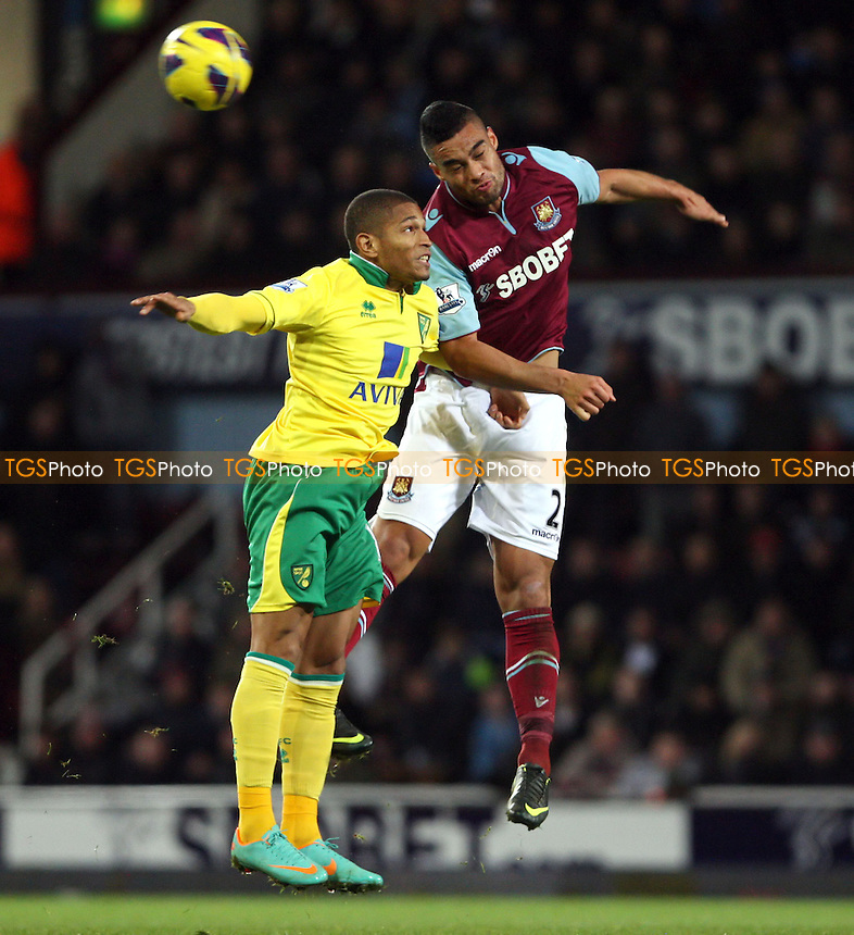 Winston Reid of West Ham and Simeon Jackson of Norwich - West Ham United vs Norwich City, Barclays Premier League at Upton Park, West Ham - 01/01/13 - MANDATORY CREDIT: Rob Newell/TGSPHOTO - Self billing applies where appropriate - 0845 094 6026 - contact@tgsphoto.co.uk - NO UNPAID USE.