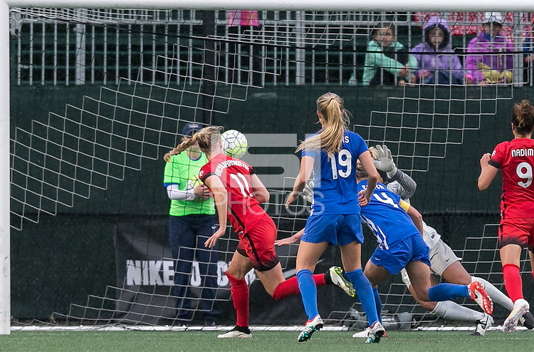 Allston, Massachusetts - May 1, 2016:  In a National Women's Soccer League (NWSL) match, Portland Thorns FC (red) defeated Boston Breakers (blue), 1-0, at Jordan Field.<br /> <br /> Dagny Brynjarsdottir heads ball for score.