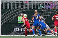 Allston, Massachusetts - May 1, 2016:  In a National Women's Soccer League (NWSL) match, Portland Thorns FC (red) defeated Boston Breakers (blue), 1-0, at Jordan Field.<br /> <br /> Dagny Brynjarsdottir heads ball for score.