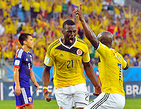 CUIABA - BRASIL -24-06-2014. Jackson Martinez (#21) jugador de Colombia (COL) celebra un gol anotado a Japón (JPN) durante partido del Grupo C de la Copa Mundial de la FIFA Brasil 2014 jugado en el estadio Arena Pantanal de Cuiaba./ Jackson Martinez (#21) player of Colombia (COL) celebrates a goal scored to Japan (JPN) during the macth of the Group C of the 2014 FIFA World Cup Brazil played at Arena Pantanal stadium in Cuiaba. Photo: VizzorImage / Alfredo Gutiérrez / Contribuidor