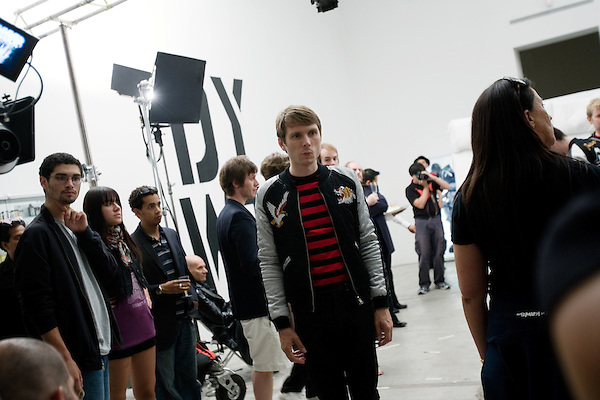 "July 29, 2005. New York , NY.. Lead singer Alex Kapranos waits for the filming to begin..Behind the scenes with Franz Ferdinand during the  filming of the music video "" Do You Want To"" in  Manhattan."