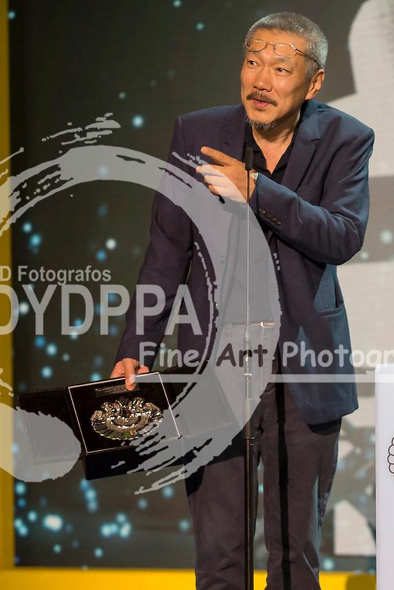 Hong Sang Soo poses