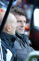 Saturday 17 November 2012<br /> Pictured L-R: Goalkeeping coach Adrian Tucker and Swansea manager Michael Laudrup<br /> Re: Barclay's Premier League, Newcastle United v Swansea City FC at St James' Park, Newcastle Upon Tyne, UK.