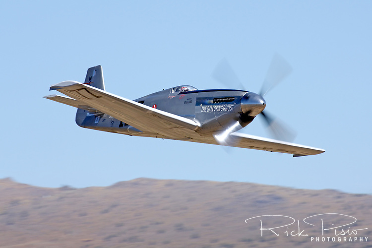 Unlimited Air Racer The Galloping Ghost flying low and fast through the Valley of Speed during the 2010 National Championship Air Races in Reno, Nevada. The aircraft is owned and flown by Jimmy Leeward of Ocala, Florida.