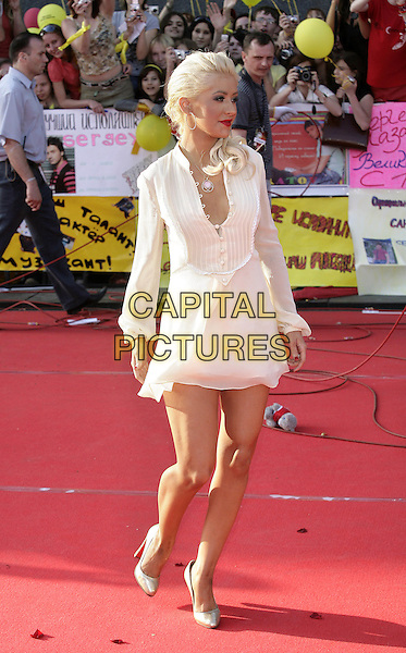 Christina Aguilera.Opening of the award of MUZ TV, Moscow, Russia..June 1st, 2007.full length white dress mini   .CAP/PER/PK.©PK/PersonaStars/CapitalPictures