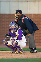 Jared Avchen #22 of the East Carolina Pirates looks to the dugout for a sign at Clark-LeClair Stadium on February 19, 2010 in Greenville, North Carolina.   Photo by Brian Westerholt / Four Seam Images