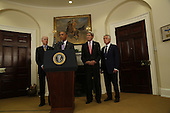 United States President Barack Obama (C) delivers a statement on the legislation he sent to Congress to authorize the use of military force (AUMF) against ISIL, while US Vice President Joe Biden (L) and Secretary of States John Kerry (2R) and Secretary of Defense Chuck Hagel (R) listen, in the Roosevelt Room of the White House, in Washington, DC on February 11, 2015. <br /> Credit: Aude Guerrucci / Pool via CNP