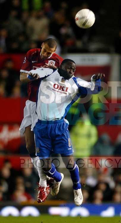 Manchester United's Rio Ferdinand and Portsmouth's Andy Cole