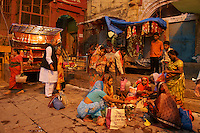 street life and little shops on the plaza of the main Ghat of river Ganga in Varanasi (Dashaswamedh Ghat)
