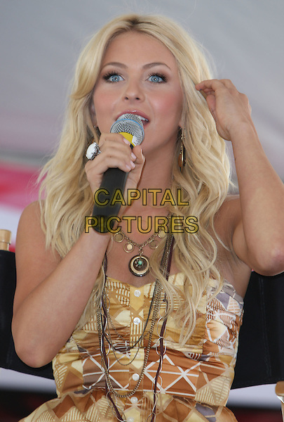 JULIANNE HOUGH.2008 CMA Music Festival Day Three during the ABC Block Party held on Fifth Avenue,  Nashville, Tennessee .07 June 2008..country music half length microphone speaking sitting hand brown print dress arm necklace.CAP/ADM/MJT.©MJT/Admedia/Capital Pictures