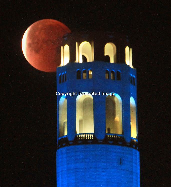 A total lunar eclipse over San Francisco landmarks.