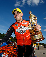 Aug 21, 2016; Brainerd, MN, USA; NHRA pro stock motorcycle rider Andrew Hines celebrates after winning the Lucas Oil Nationals at Brainerd International Raceway. Mandatory Credit: Mark J. Rebilas-USA TODAY Sports